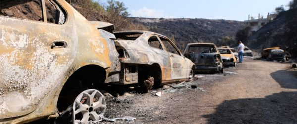 Image: Intense fires in Lebanon's Chouf region charred vehicles at a garage owned by Damour resident Walid Mansour. Credit: Timour Azhari/Al Jazeera